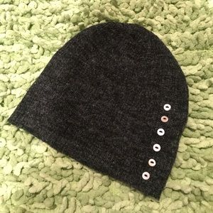 Grey knit beanie with white button detail